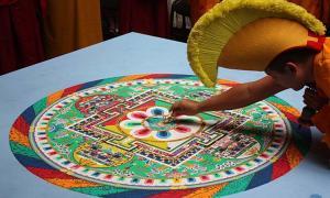 A Buddhist monk creating a mandala