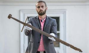 Bartłomiej Bartecki, director of the Museum in Hrubieszów presents the sword found in the Commune of Mircze.