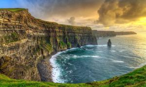 Cliffs of Moher at sunset, Ireland. The Milesians were the last wave of invaders who came to Ireland.