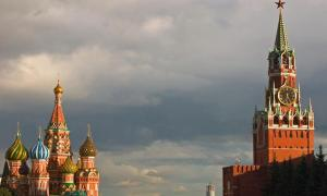 St. Basil's Cathedral and the Spasskaya Tower of Kremlin in Moscow's Red Square