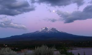 """Full moon rising over Mount Shasta, as seen from northern valley."""
