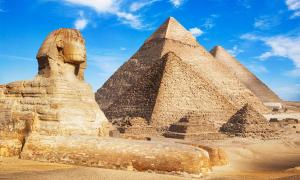 """Elon Musk's """"Ancient Aliens"""" Twitter comment has caused many questions about who built the pyramids and alien life.                       Source: merydolla / Adobe Stock"""