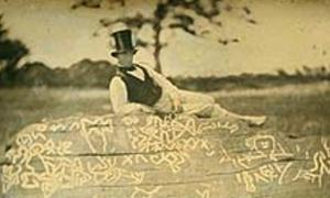 An 1853 reversed image of Seth Eastman (known for documenting Native American life in the 1800s) on top of the boulder known as Dighton Rock.