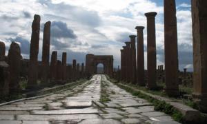 Roman Ruins of Timgad (Wilaya of Batna, Algeria). Street leading to the Arch of Trajan.