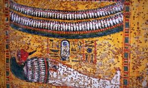 Scene from the decorated upper portion of the East wall in KV62 shows the mummified Tutankhamun lying supine within a tall, garland-bedecked shrine; design by Anand Balaji (Photo credit: Meretseger Books); Deriv.