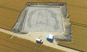 Archaeologists looking at aerial photography found a hidden long barrow, or Neolithic burial chamber, hidden beneath a wheat field Credit: Archaeological Field School, University of Reading