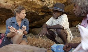 Researcher Elspeth Hayes with Mark Djandjomerr and traditional owner May Nango extracting comparative samples at a cave adjacent Madjedbebe. Credit: David Vadiveloo / Gundjeihmi Aboriginal Corporation