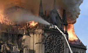 The Notre Dame Cathedral in Paris on fire.