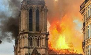 Fire in the frame of Notre Dame cathedral.