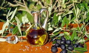 Modern glass carafe of olive oil.