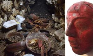 A stone cup in the center of burial 80 surrounded by bones during excavation. And the jade mask found in the burial, painted red with cinnabar paint