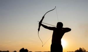Man using bow and arrow. Credit: Oksana Volina / Adobe Stock
