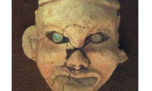 Painted clay goddess face with eyes inset with jade, found at Goddess Temple, Niuheliang.