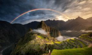 """Do the rainbows over Machu Picchu end in the long-lost """"pot of gold"""" that is Paititi, the last city of the Incas. Source: Photography by KO / Adobe Stock"""
