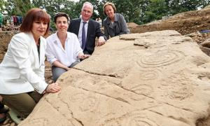 L-R: Minister for Culture, Heritage and the Gaeltacht Josepha Madigan; Dr. Cliodhna Ni Lionain, Devenish's lead archaeologist; Devenish executive chairman Owen Brennan; and his wife Prof. Alice Stanton and one of the decorated kerb stones.