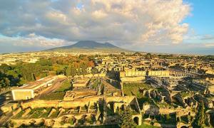 Ruins of Pompeii seen from the above with a drone, with the Vesuvius in the background