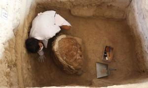 Archaeologist carrying out excavations at the pyramid of the bees.