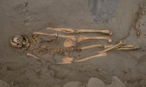 Ancient remains of a Peruvian shark fisherman, who was buried with two additional left legs.