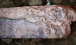 The Pictish stone was reused as a horizonal grave slab in the 1790s - hence the inscription in the corner. Source: NOSAS