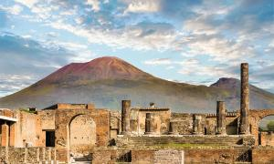 "Archaeologists have unearthed ""recycling sites"" outside the walls of ancient Pompeii, showing the Pompeiians once recycled trash in an a very effective manner. Pictured: shot of the ruins with Mount Vesuvius in the background.      Source: dbvirago / Adobe stock"