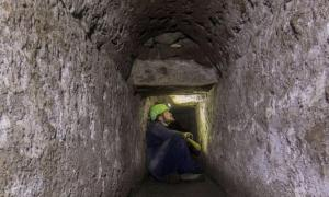 Tunnel within ancient Pompeii's drains system with archaeologist inside.       Source: Archaeological Park of Pompeii