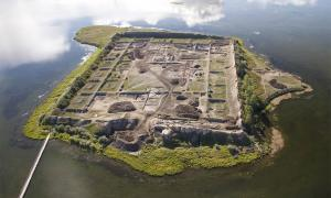 This is an aerial view of Por-Bajin from the west. The complex is situated on an island in a lake. Scientists have pinned its construction on the year 777 AD, using a special carbon-14 dating technique, based on sudden spikes in the carbon-14 concentration.        Source: Andrei Panin / PNAS