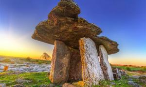 Poulnabrone portal tomb in Burren at sunrise, Ireland           Source: Patryk Kosmider