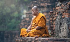 Buddhist monk meditation in temple             Source: Sasint / Adobe Stock