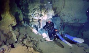Divers exploring the underwater caves where the amphorae were found. (SONARS / Facebook)