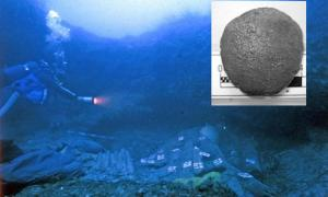 Main: A diver searches the Relitto del Pozzino shipwreck (Not Only Chemistry). Inset: One of the medicinal tablets. Image via PNAS/Giachi et. al.