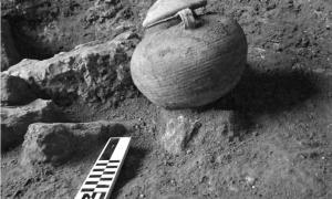 Roman cooking pot with most likely the remains of a cremated Roman Legionary, found at the Roman military camp discovered at Legio, by Tel Megiddo