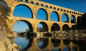 Roman Bridge Pont du Gard in France. Credit: JackF / Adobe Stock