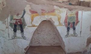 Detail of a mural around a niche in one of the Roman tombs found at Beir Al-Shaghala archaeological site in Egypt's Dakhla Oasis.