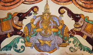 A painting of Lakshmi on the inner walls of the Tanjore Big temple. Gold is said to symbolize this goddess.