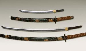 Antique Japanese daishō, the traditional pairing of two Japanese weapons which were the symbol of the samurai, showing the traditional Japanese sword cases (koshirae) and the difference in size between the katana (bottom) and the smaller wakizashi (top).