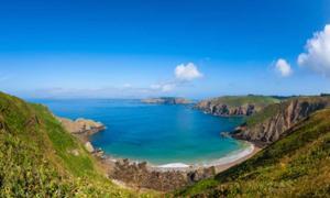 Remote beach and rocky coastline on Sark Island. Source: allard1 / Adobe Stock.