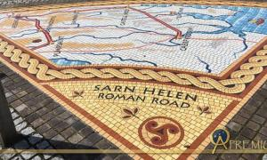 Pavement mosaics showing 'Sarn Helen' routes in Wales, one of which lies between the two mosaics.