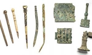 Scholarly tools from left: quills, styluses and book clasps.