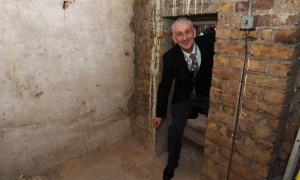 Sir Lindsay Hoyle, Speaker of the House of Commons, poses inside the newly-rediscovered secret passage.       Source: Jessica Taylor / UK Parliament