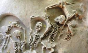 Some of the shackled skeletons found in a mass grave near Athens, Greece