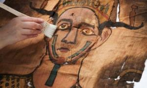 Detail of the face on the mummy shroud from around 9 BC which was recently recovered from a hidden package in the National Museum of Scotland's collections.