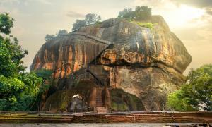 Bird flying over Sigiriya / Lion Rock in Sri Lanka.         Source: Givaga / Adobe stock