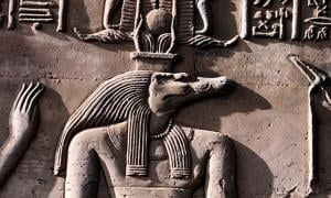 Close up of Sobek as represented on a relief from the Temple of Kom Ombo shows Sobek with typical attributes of kingship, including a was-scepter and royal kilt.