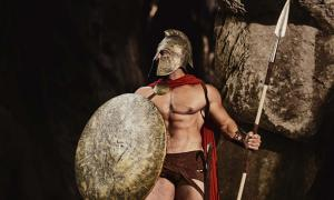 Spartan warrior holding spear and shield.