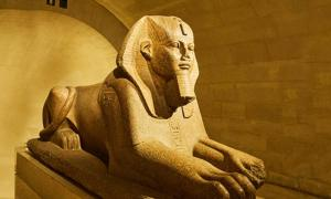 An Egyptian sphinx with a human head
