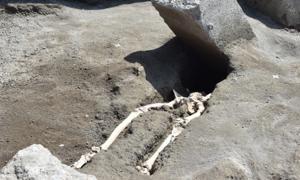 Stone block and decapitated skeleton