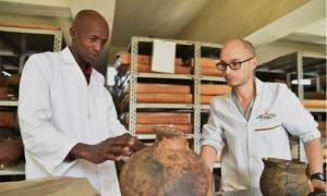 Paper co-author Steven Goldstein discussing pottery traditions associated with early farmers in Kenya with Christopher Kirwa of NMK Source: Jennifer Miller