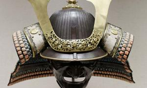 Japanese parade helmet, made from iron, gilded copper, lacquered leather, silk