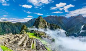 Overview of Machu Picchu, agriculture terraces and Huayna Picchu peak in the background   Source: davidionut / Adobe stock