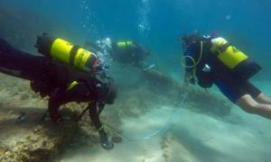 Underwater archaeologists off the coast of Nabeul in northeastern Tunisia at the site of the ancient Roman city of Neapolis.